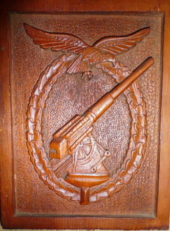 German PoW wood carving of anti-aircraft symbol (Henderson Homefront Collection)